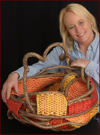 Tina Puckett holding her basket Dragon Pouch